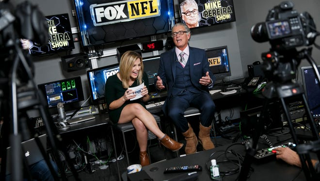 Former NFL VP of officiating and current Fox analyst Mike Pereira, right.