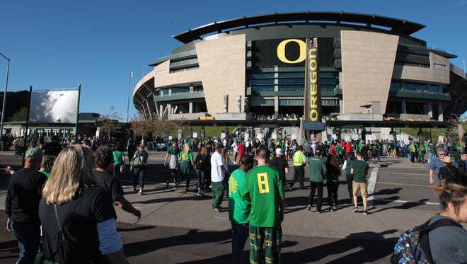 Sep 26, 2015; Eugene, OR, USA; Oregon Ducks and Utah Utes fans stand outside the stadium before the game at Autzen Stadium. Mandatory Credit: Scott Olmos-USA TODAY Sports