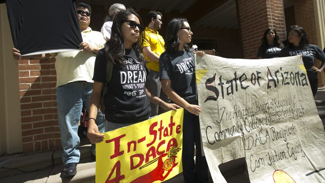On May 6, 2015, students celebrate a decision in favor of the Maricopa County Community College District, which began allowing DACA recipients to receive in-state tuition. The Arizona Court of Appeals overturned that ruling last week.