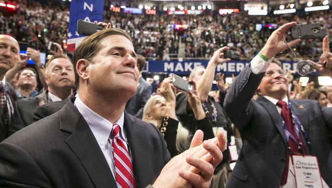 Gov. Doug Ducey cheers the nomination of Donald Trump at the Republican National Convention