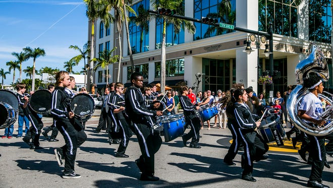 Baron Collier High School marching band performs during the Rev. Martin Luther King Jr. parade along Fifth Avenue South in downtown Naples on Monday, Jan. 15, 2018.