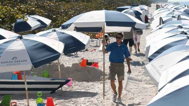 File photoCollier County beaches drew sun-seekers from all over, in January.