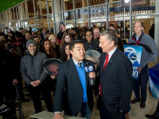 WXYZ reporter Andy Choi, left, interviews station manager