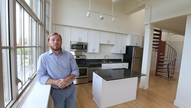 Developer Patrick Dutton stands in a finished two bedroom loft apartment on the fourth floor of the Bevier Memorial Building at 42 South Washington St. in Rochester. Dutton is renovating the historic building into loft apartments.