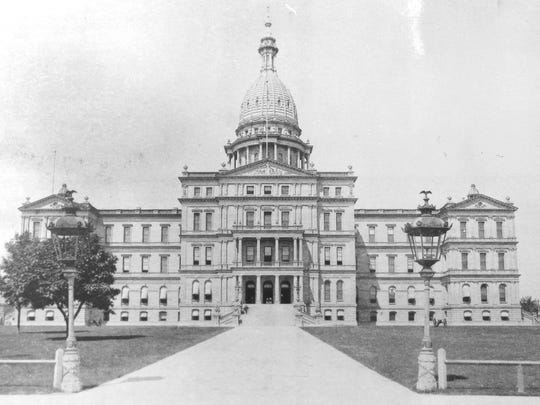 1890 - For many years the entrance to Capitol Square was framed by two large gas lamp posts crafted by the Samuel J. Creswell Co. of Philadelphia. Creswell also supplied the iron for the Capitol's dome.