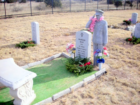 One of the more unusual grave markers at the fort received a wreath and had other decorations apparently added by the family.