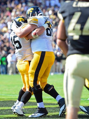 Sep 27, 2014; West Lafayette, IN, USA; Iowa Hawkeyes running back Mark Weisman (45) and offensive linesman Brandon Scherff (68) celebrate a touchdown during the second half of the game at Ross Ade Stadium. The Iowa Hawkeyes beat the Purdue Boilermakers 24 to 10. Mandatory Credit: Marc Lebryk-USA TODAY Sports