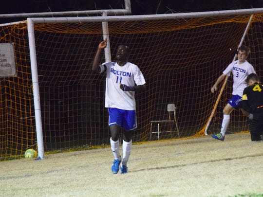 Bolton High School's Nic Mboungou (11, left) gives thanks after scoring Bolton's second goal against Lutcher Wednesday evening.