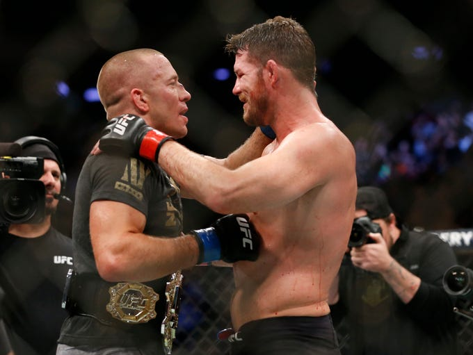Michael Bisping, right, congratulates Georges St-Pierre