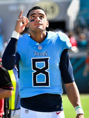 Titans quarterback Marcus Mariota points to the sky after defeating the Jaguars 9-6 on Sunday.