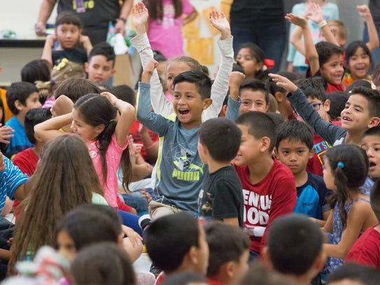 Students at University Hills cheered as the winners of the classes that read the most during the Scholastic Summer Reading Challenge were announced at the end of the celebration for the school being named the New Mexico's top performing school in the Scholastic Summer Reading Challenge. Wednesday, October 18,2017.