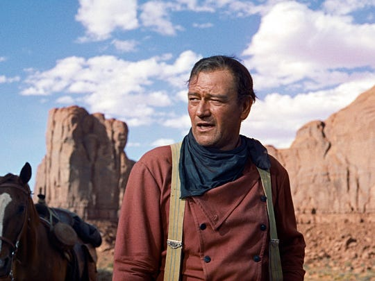 In this photo released by Warner Bros., actor John Wayne plays Ethan Edwards in the newly remastered and restored special edition DVD of The Searchers.  Director John Ford and frequent leading man Wayne forged one of Hollywood's most enduring partnerships.  Ford and Wayne rode again at the 59th International film festival in Cannes, which featured a documentary about their collaboration.