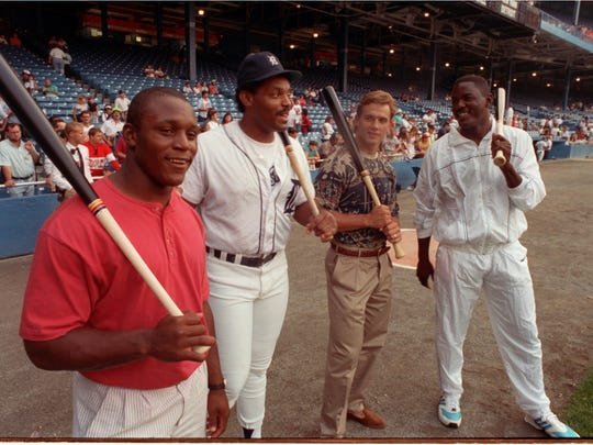 A top star from each of Detroit's four major professional sports teams-the Lions' Barry Sanders, the Tigers' Cecil Fielder, the Red Wings' Steve Yzerman and the Pistons' Joe Dumars (left to right) meet Thursday before the Tigers-Yankees game on September 13, 1990 at Tiger Stadium.