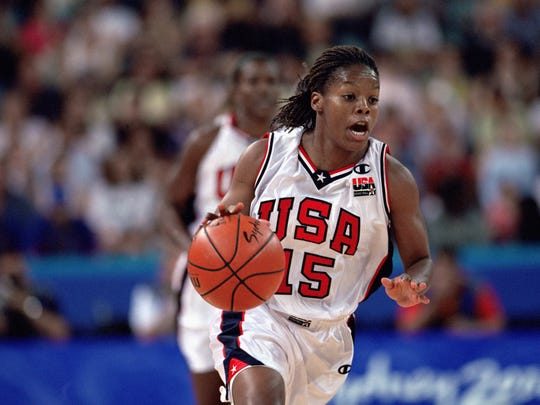 SYDNEY - SEPTEMBER 20:  Nikki McCray #15 of the United States dribbles the ball against Russia during the Women's Basketball competition, part of the 2000 Sydney Summer Olympics at the Sydney Superdome on September 20, 2000 in Sydney, Australia.  The United States defeated Russia 88-77.  (Photo by: Doug Pensinger/Getty Images)