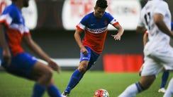 FC Cincinnati forward Andrew Wiedeman (23) winds up