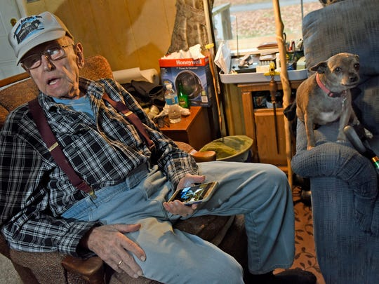 Richard Lehman spends time with his dog, Rascal, in is home on Iron Bridge Road, northwest of Chambersburg on Monday, December 12, 2016. Lehman's family moved before Letterkenny Army Depot came in, but kept close ties to the community.