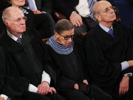 Supreme Court Justice Ruth Bader Ginsburg, sitting between Justice Anthony Kennedy and Justice Stephen Breyer, appears to nod off as President Barack Obama delivers his State of the Union speech Jan. 20, 2015.