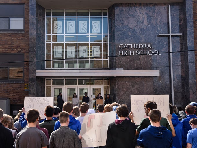 Students gather near the entrance to Cathedral High