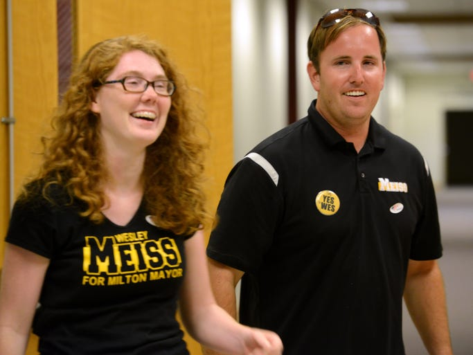 Wesley Meiss and his fiance Lauren Basford have a quiet celebration after hearing election restults Tuesday night at the Santa Rosa County Supervisor of Elections Office to win the Milton mayoral race against long standing Mayor Guy Thompson.