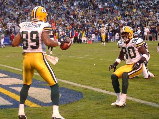 Packers wide receivers Robert Ferguson and Donald Driver celebrate Ferguson's touchdown catch.