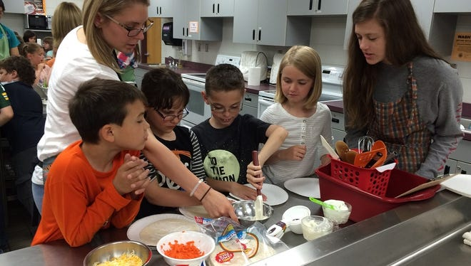 """Madison Elementary School students participated in """"high schooler for a day"""" activities when they visited Marshfield High School in this file photo."""