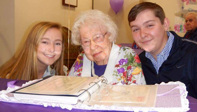 Dolores Seacrist center, celebrates her purple-themed birthday party on May 1, with Hannah Strathmeyer, great-great-niece, and Brady Strathmeyer, great-great-nephew.