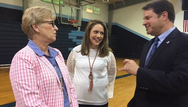 Airline athletic director Ronnie Coker visits with Airline teacher Donna Pearson and new girls basketball coach Lyndzee McConathy on Wedesday.