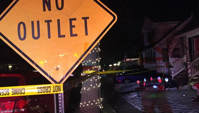 Crime-scene tape stretches around a tree decorated for the holidays near the scene of a double murder in Collingswood Saturday.