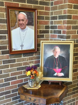 Framed portraits of Pope Francis and Bishop David Ricken are displayed in buildings on the Catholic Diocese of Green Bay campus in Allouez. Ricken will meet Pope Francis in Washington, D.C., next week at the start of the pontiff's first visit to the United States.