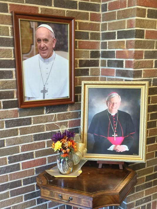Pope Francis and Bishop Ricken pics at diocese