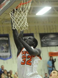 Washington's #32 Deng Gue scores in this file photo