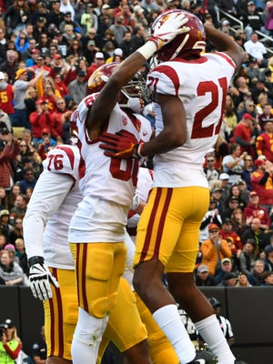 USC Trojans wide receiver Deontay Burnett (80) celebrates his touchdown reception with safety Jamel Cook (21).