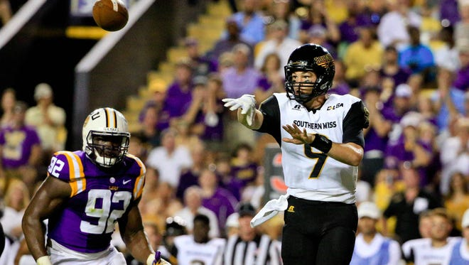Southern Miss quarterback Nick Mullens (9) throws against the LSU Tigers during the first half of their game at Tiger Stadium in Baton Rouge, Louisiana.