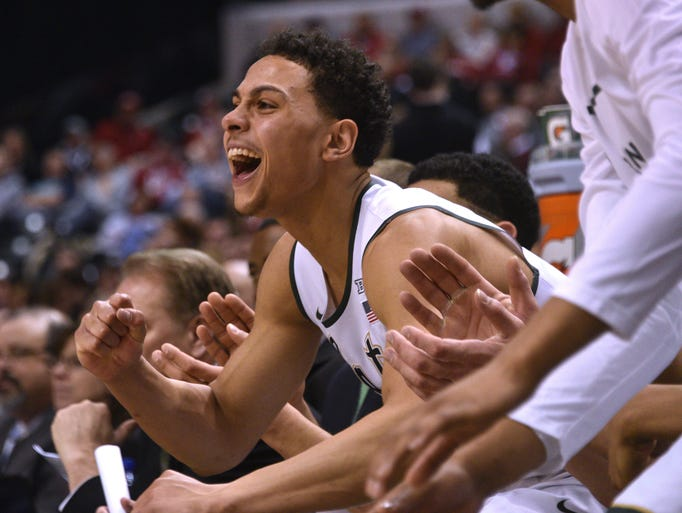 Bryn Forbes and his teammates celebrate on the bench