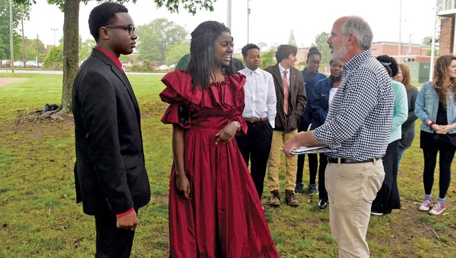 Celebration performers Carey Williams, left, and Angella Osinde talk with history teacher Chuck Yarborough at the dress rehearsal.