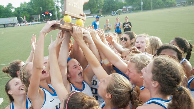 Kentucky Country Day celebrates its 14-8 victory over Sacred Heart Academy in the Kentucky highs school state lacrosse championship played at Assumption Green in Louisvlle.