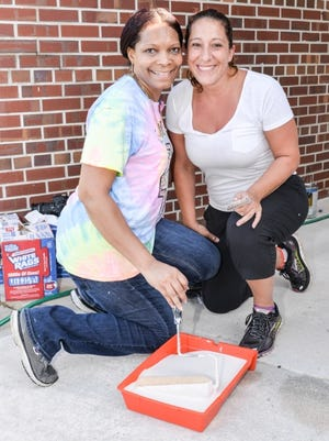Angela Hayle and Michelle Steele were among the leadership team members to pitch in and paint the Fort Pierce Woman's Club's clubhouse .