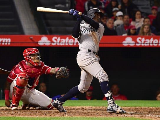 Yankees shortstop Didi Gregorius watches his solo home