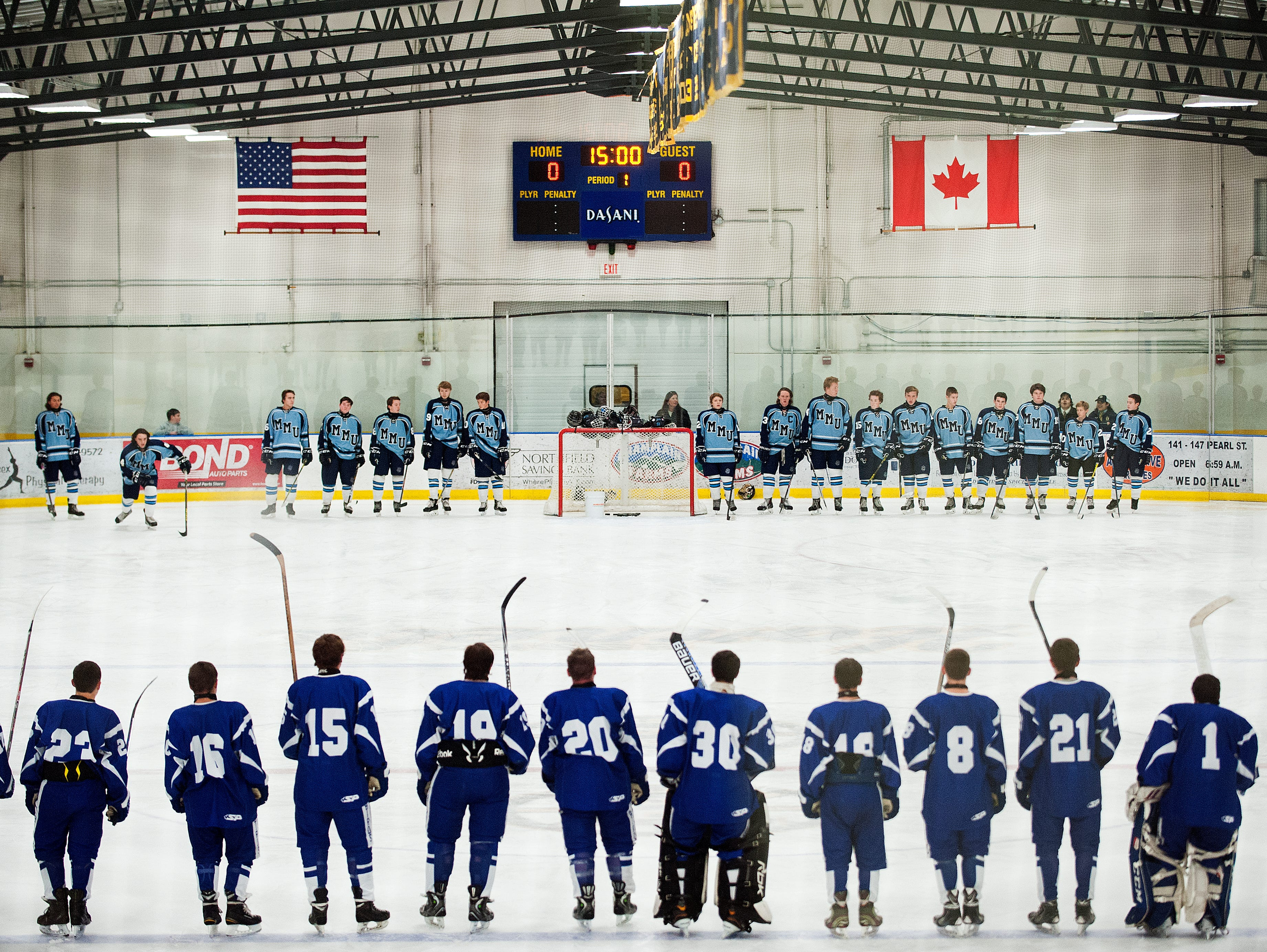 The teams line up for player introductions before the start of the boys hockey game between Missisquoi Valley and Mount Mansfield at the Essex Skating Facility on Saturday afternoon December 5, 2015 in Essex.