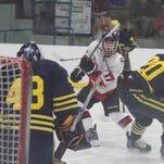 Pinckney splits 2 hockey games in showcase