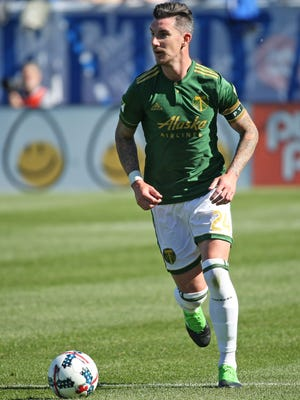 Portland Timbers defender Liam Ridgewell (24) runs with the ball against Montreal Impact during the second half at Stade Saputo.