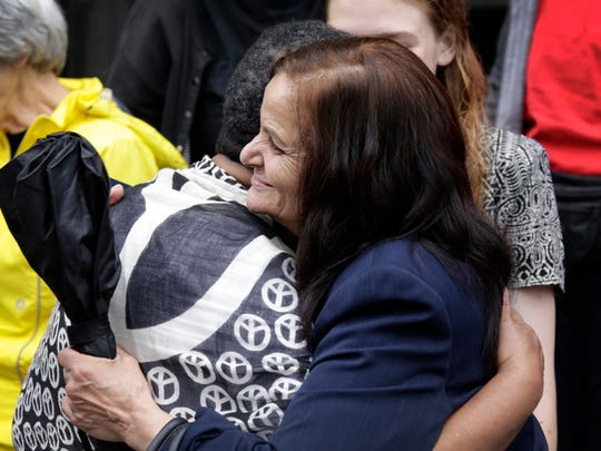 Rasmieh Odeh, right, is hugged by Contessa Miller of