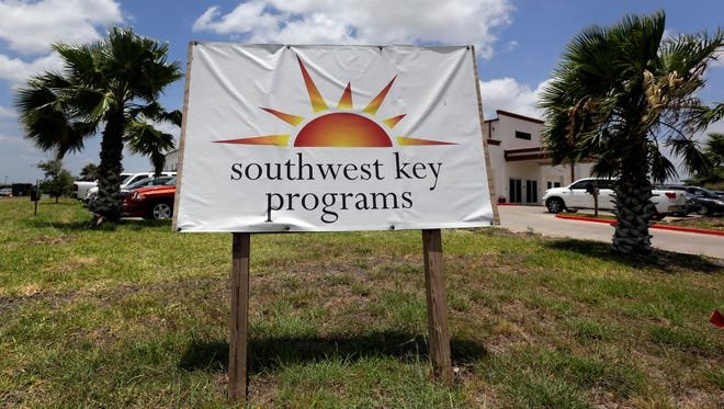 A sign stands on June 20, 2014, outside Southwest Key-Nueva Esperanza, in Brownsville, Texas, a facility that shelters unaccompanied immigrant children. The U.S. government announced on Thursday, that it plans to open three new shelters, one each in Colorado, Florida and New Mexico, to house young Central American immigrants as part of an effort to deal with a renewed influx of unaccompanied children across the border.