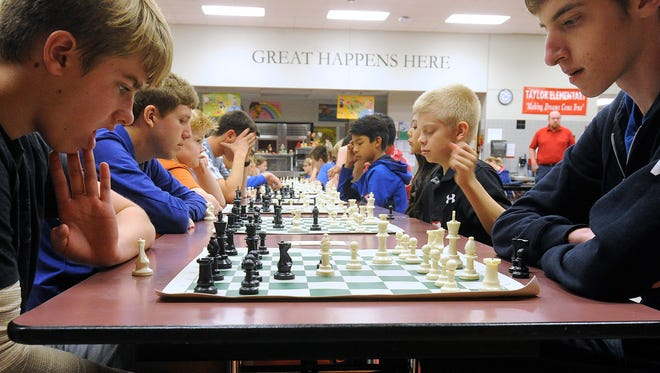 Luke Gray (left), 12, of Brownwood, looks over the board during his match against Theo McCracken, 18, during the 20th annual Scholastic Chess Tournament on Feb. 18, 2017, at Taylor Elementary School.