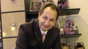 2002 photo of Isaac Larian, chief executive officer of MGA Entertainment, with fashion dolls from the Bratz collection  in the North Hills section of Los Angeles.
