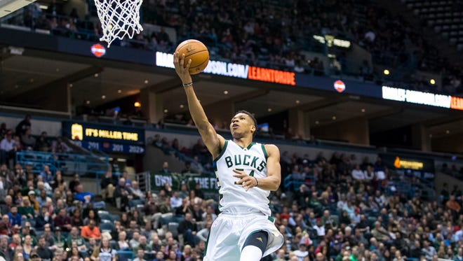 Bucks forward Giannis Antetokounmpo soars in for a basket against the Knicks on Wednesday.