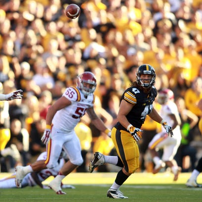 Iowa's John Kenny looks to make a catch in a game against