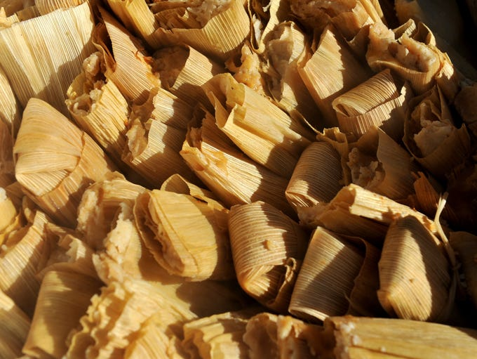 A cooking pot holds about 100 freshly made tamales