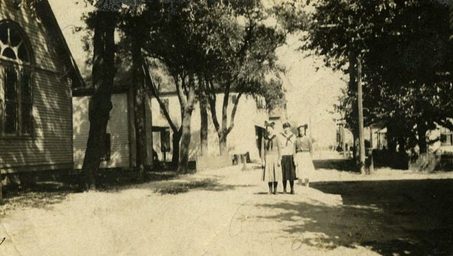 Residents pose for a photo in a bygone era along Stockton Avenue in Greenbackville in this historic photo. The town was founded in 1867 on Chincoteague Bay, and is celebrating its 150th birthday on Sunday, Dec. 10.