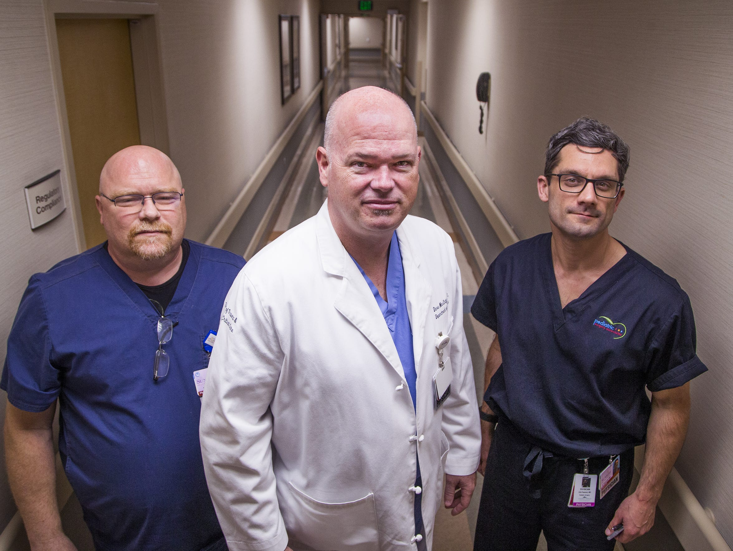 Trauma surgeon Dr. Dave MacIntyre (middle) and pediatric physicians Drs. Jim Andrus (left) and Erik Pearson.